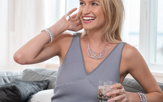 Woman at home wearing Touchstone Crystal Pearls